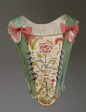 green damask covered stays - late end of 18th c, european green stays, lacing variations of 18th c, CF Crossed Lacing Stays - 1750-75, pink roses and red pretty stays, living history dressing, how do I dress like reenactors, theatre costume, how do I lace my stays, what are the different methods of lacing stays and corsets, what is straight lacing, online hot to videos for historical costumes, how to do straight lacing, photo examples of lacing corsets and stays, how do i dress myself in 18th c costume, georgian costumiers, handbound historical costumes and supplies