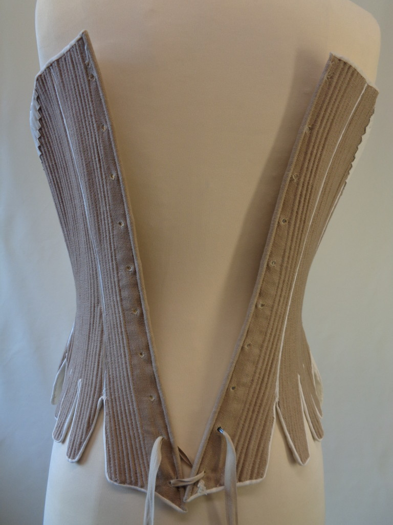 how do I lace my stays, what are the different methods of lacing stays and corsets, what is straight lacing, online hot to videos for historical costumes, how to do straight lacing, photo examples of lacing corsets and stays, how do i dress myself in 18th c costume, georgian costumiers, handbound historical costumes and supplies