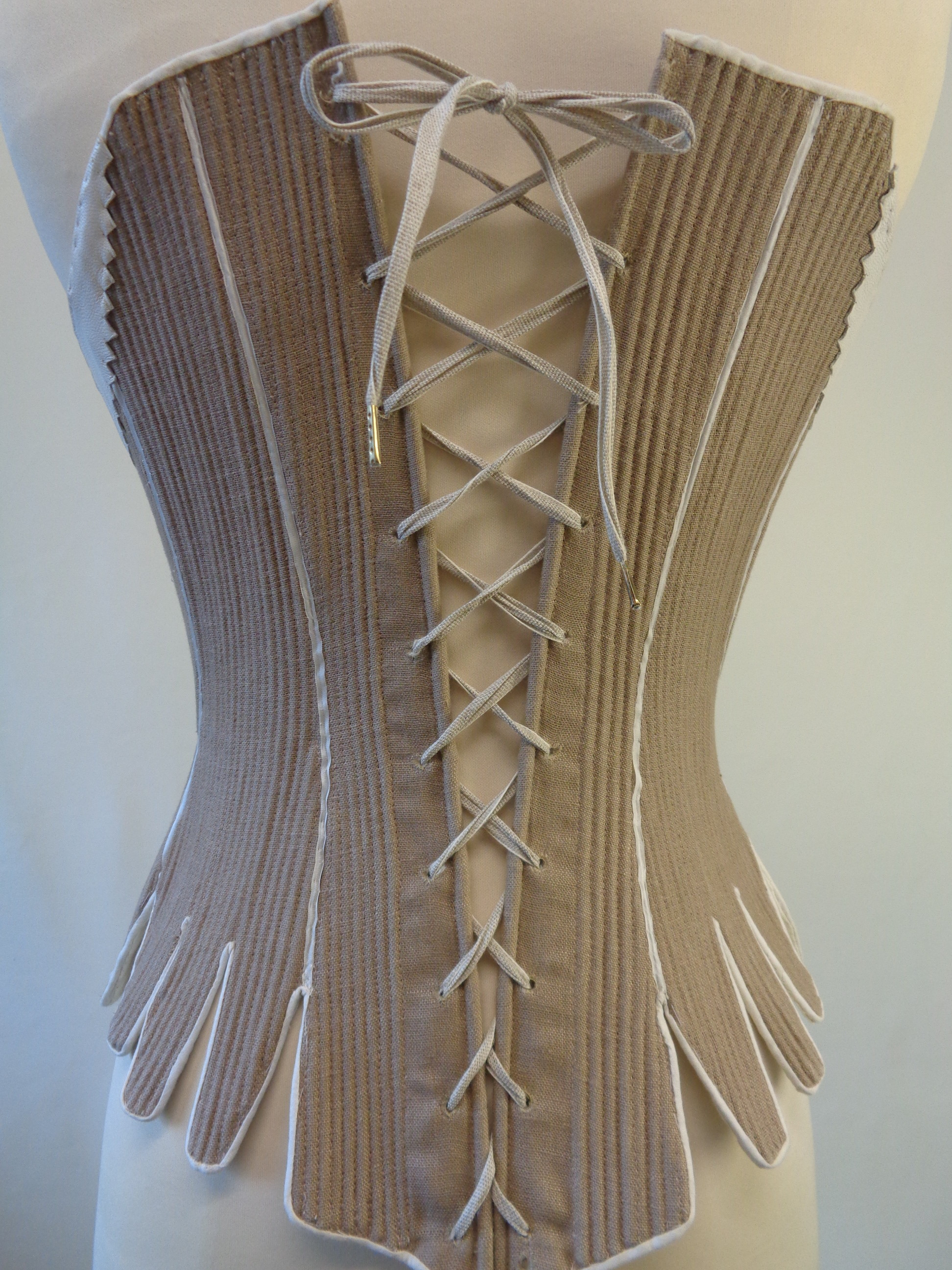 lacing variations of 18th c, CF Crossed Lacing Stays - 1750-75, pink roses and red pretty stays, living history dressing, how do I dress like reenactors, theatre costume, how do I lace my stays, what are the different methods of lacing stays and corsets, what is straight lacing, online hot to videos for historical costumes, how to do straight lacing, photo examples of lacing corsets and stays, how do i dress myself in 18th c costume, georgian costumiers, handbound historical costumes and supplies