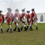 Soldiers in 18th c military uniform, handbound historical costumiers