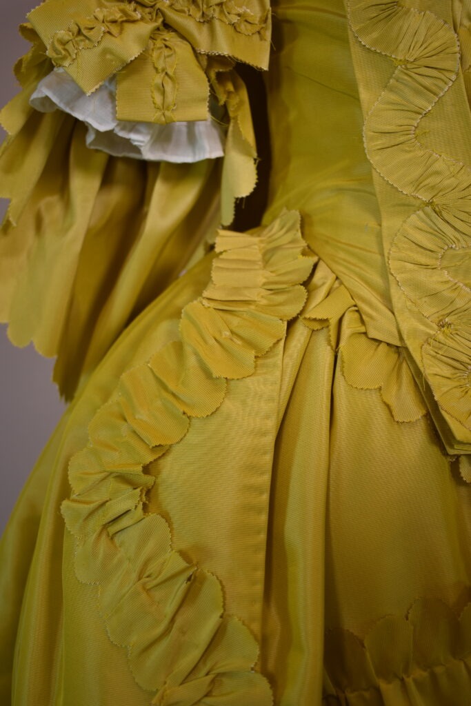 1760s fashion - yellow sack back gown with furbelow trim